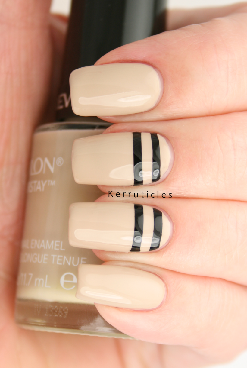 Beige-with-stencilled-black-lines-nails
